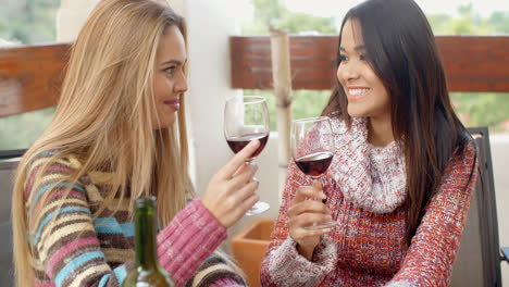 Two-Girls-Having-Glasses-of-Wine-at-the-Cafe