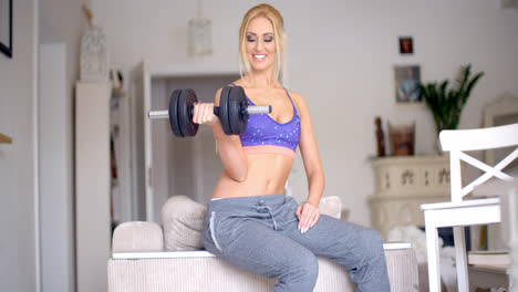 Sexy-sporty-blond-woman-exercising-with-weights
