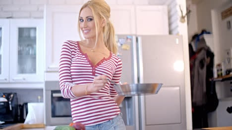 Sexy-vivacious-woman-making-the-dinner