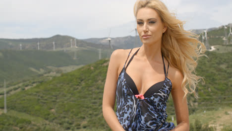 Blond-Woman-on-Windy-Hill-near-Wind-Farm
