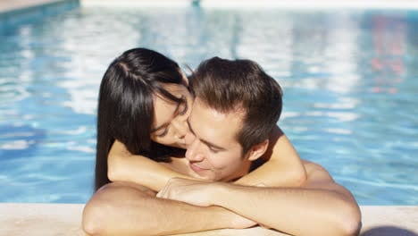 Beautiful-woman-cuddles-with-her-boyfriend-in-pool