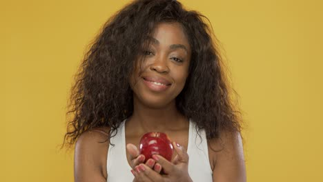 Positive-female-sharing-apple-with-camera