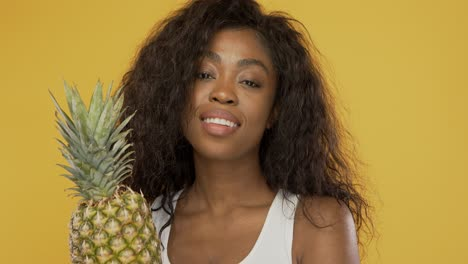 Positive-woman-with-pineapple