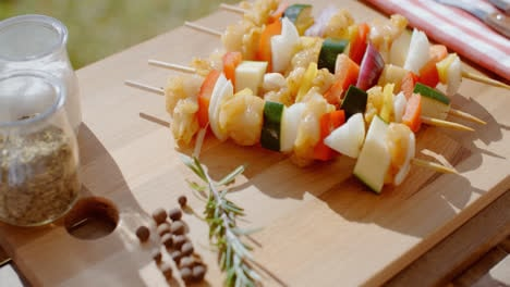 Four-chicken-and-vegetable-kabobs-on-cutting-board