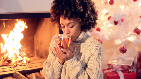 Young-woman-drinking-spicy-lemon-tea