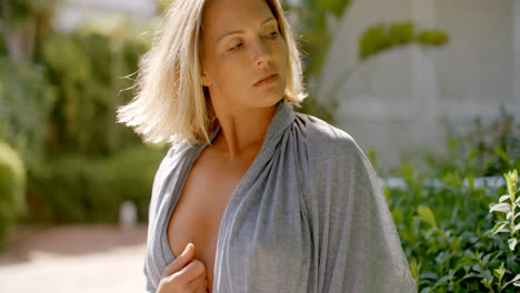 Blond-Woman-Wearing-Open-Grey-Robe-in-Garden
