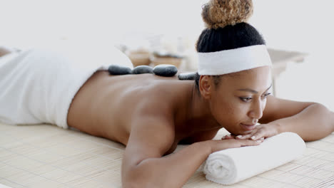 Woman-Getting-Hot-Stones-Massage-At-Spa