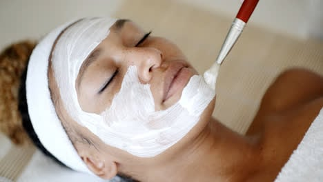 Cosmetician-Applying-Facial-Mask