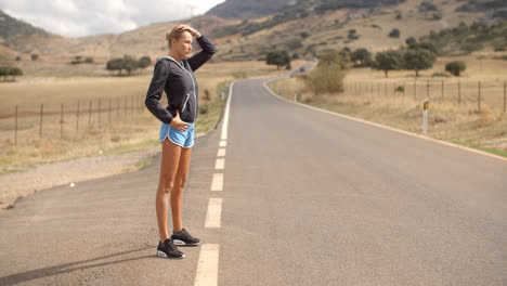 Sporty-Woman-Standing-Alone-on-the-Road