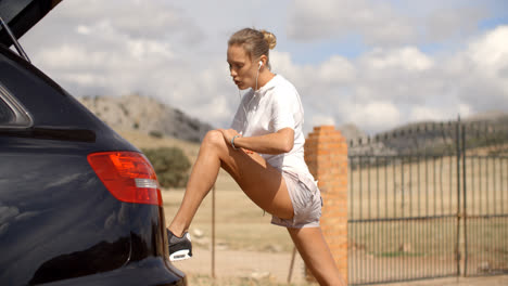 Sporty-Woman-Stretchs-Out-