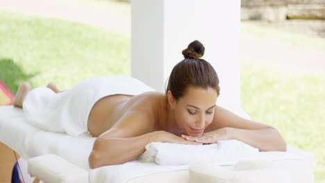 Tranquil-spa-customer-relaxes-on-table