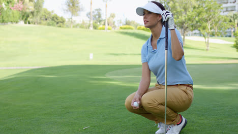Woman-wearing-white-visor-and-blue-polo-shirt