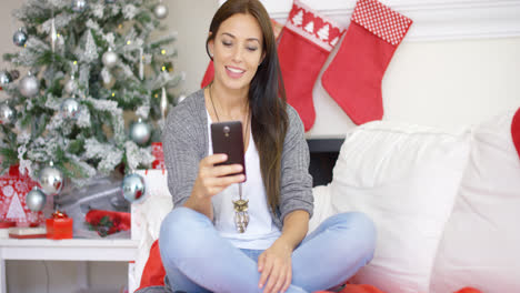 Young-woman-checking-for-Christmas-messages