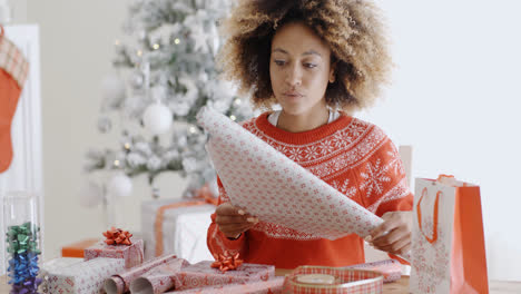 Happy-young-woman-wrapping-presents