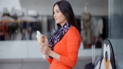 Attractive-young-woman-eating-an-ice-cream-cone