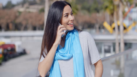 Enthusiastic-female-using-phone-outdoors