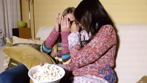 Girls-Covering-Faces-While-Watching-Horror-Movie