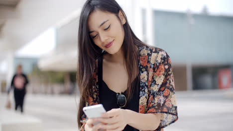 Young-woman-sitting-reading-a-text-message