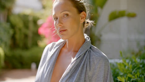 Woman-in-Grey-Robe-Outdoors-Looking-at-Camera