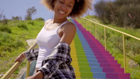 Woman-Has-Fun-On-The-Colorful-Stairs-