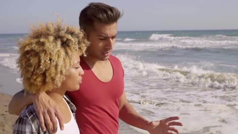 Young-Mixed-Race-Couple-Standing-On-The-Beach