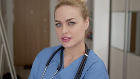Adorable-female-doctor-close-up-potrait-Standing-and-looking-at-camera