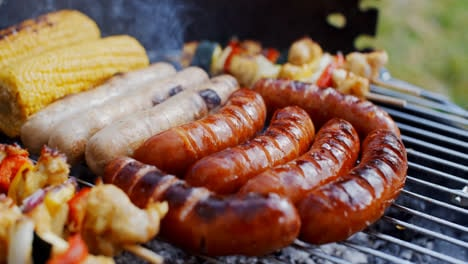 Sausages-and-vegetables-cooking-on-grill