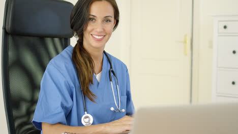 Beautiful-female-doctor-at-laptop-computer