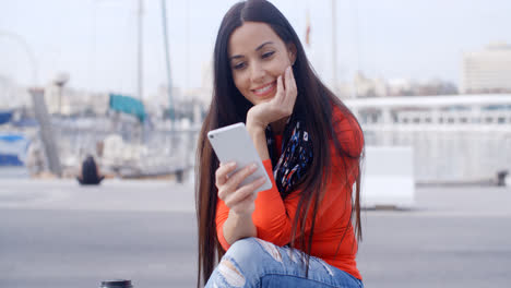 Attractive-woman-reading-a-text-message