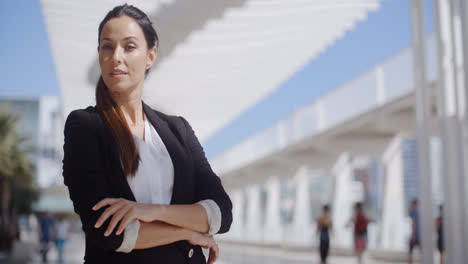 Thoughtful-businesswoman-with-folded-arms