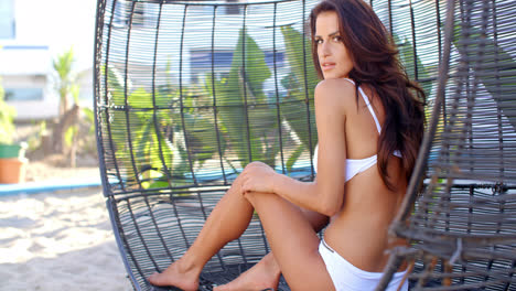 Close-Up-Video-of-Woman-Sitting-in-Wicker-Chair