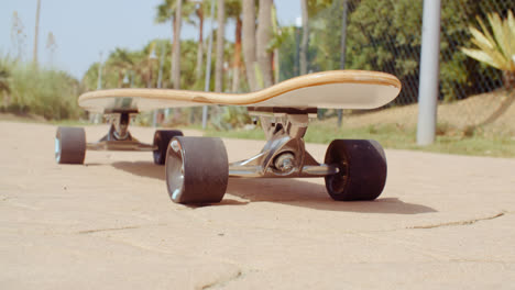 Longboard-Resting-on-the-Ground-at-the-Street