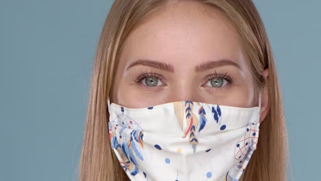 Close-up-portrait-of-beautiful-woman-wearing-stylish-face-mask-Protection-against-viruses-pollution