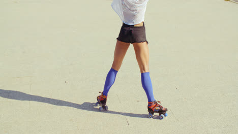 Close-Up-of-Girl-Riding-Roller-Skates