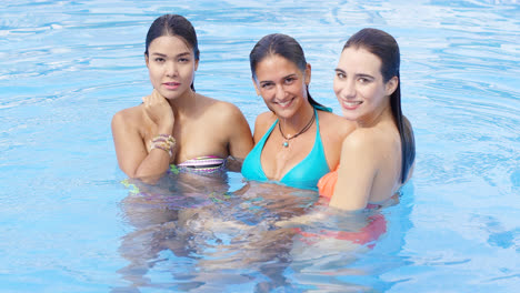 Bikini-wearing-beauties-stand-in-the-pool