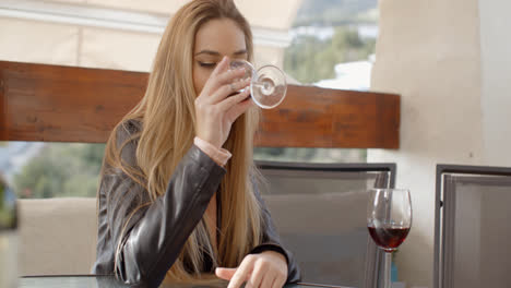 Lonely-woman-drinking-wine