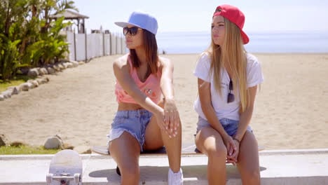 Two-trendy-young-women-with-skateboards