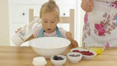Cute-baby-baking-with-woman-in-a-kitchen