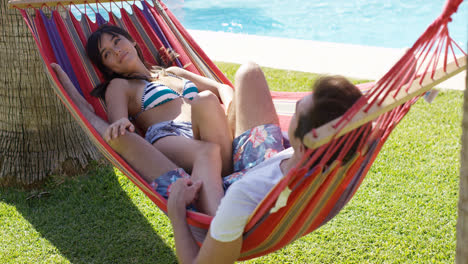 Young-holiday-couple-relaxing-in-a-hammock