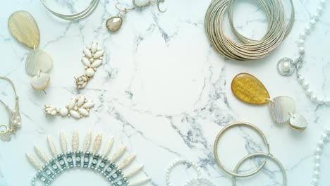 Various-jewelry-for-a-female-Elegant-style-Placed-on-marble-table