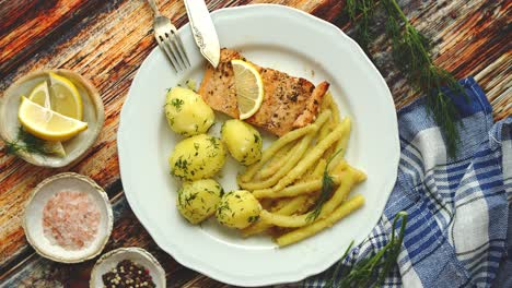 Fresh-and-tasty-baked-salmon-served-with-young-boiled-potatoes-and-yellow-bean-