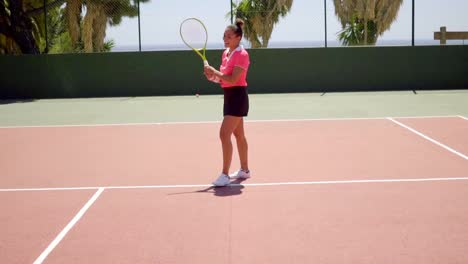 Triumphant-young-female-tennis-player