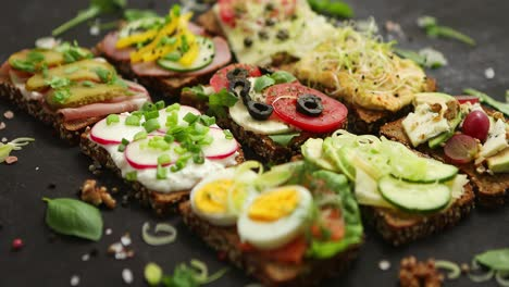 Top-view-of-different-decorated-sandwiches-as-appetizer-Healthy-food-Vegetable-meal