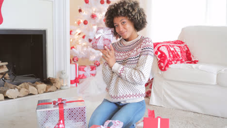 Pretty-young-woman-checking-her-Christmas-gifts