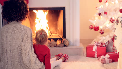 Mother-and-child-warm-up-by-the-fireplace