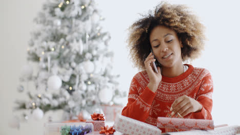 Young-woman-wrapping-gifts-at-Christmas
