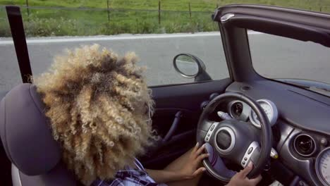 Young-woman-driving-a-cabriolet
