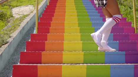 Sexy-young-woman-an-a-flight-of-rainbow-stairs