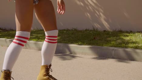 Female-Legs-On-Vintage-Roller-Skater-On-The-Road-