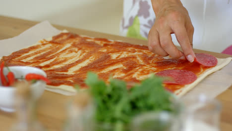 Woman-making-a-traditional-Italian-pizza
